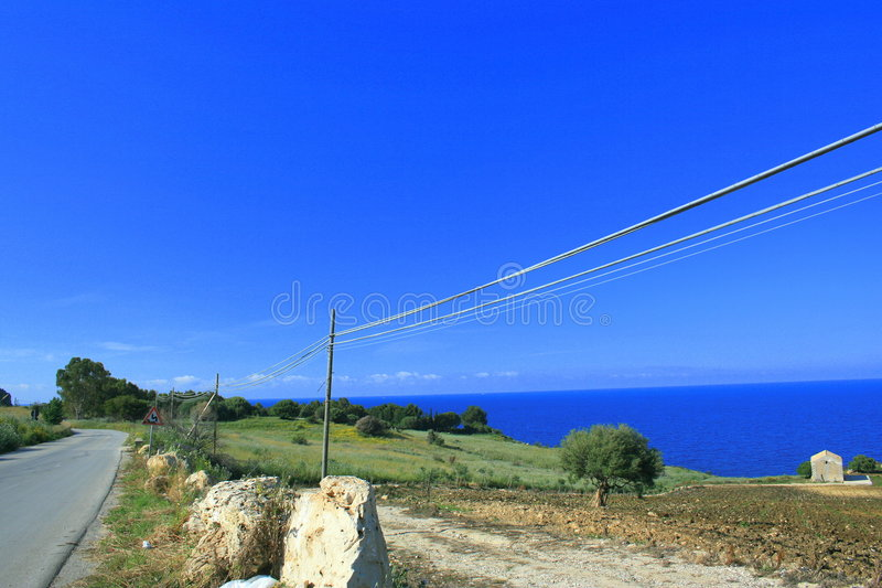 Summer Road in the Blue. Landscape. One House on Blue. Mediterraneo. Orizont. Season summer. Sicily. Italy stock images
