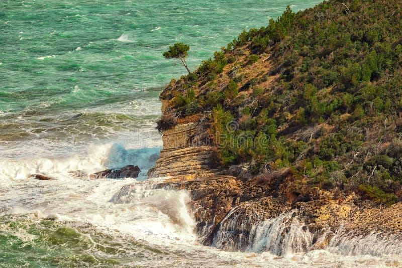 Summer rocky sea coast near Architello Arch of San Felice on the Gargano peninsula. Above the cliffs at the coastline of Vieste. Summer rocky sea coast near stock photography