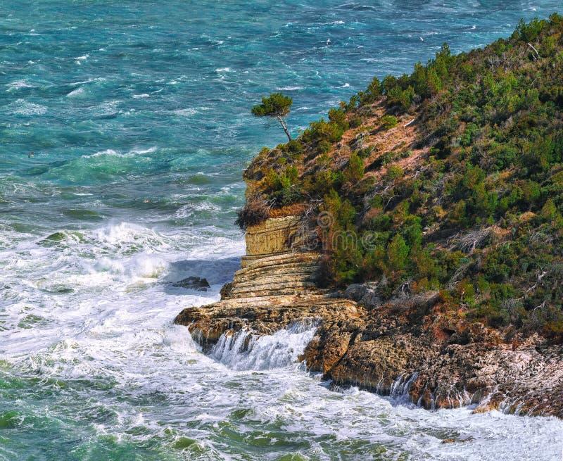 Summer rocky sea coast near Architello Arch of San Felice on the Gargano peninsula. Above the cliffs at the coastline of Vieste. Summer rocky sea coast near stock images