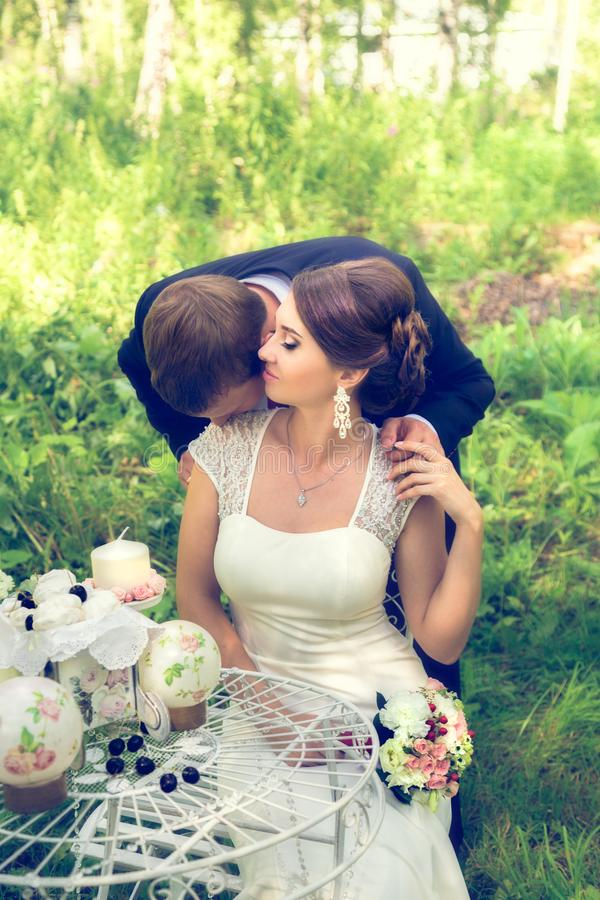 Summer romantic wedding in Provence style. In the forest, on the green grass royalty free stock images