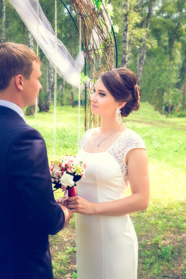 Summer romantic wedding in Provence style. In the forest, on the green grass royalty free stock photo