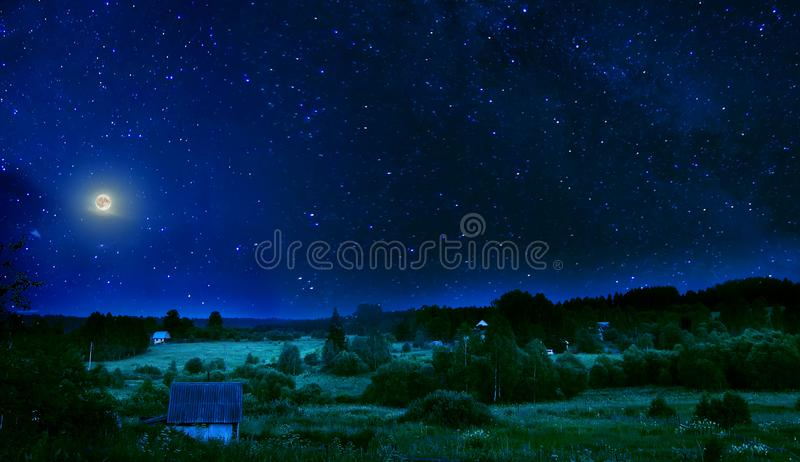 Summer rural night with full moon and shimmering stars on sky royalty free stock photos