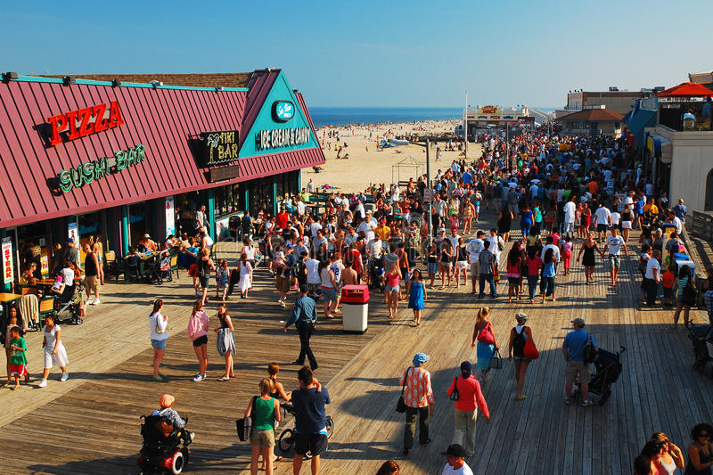Summer`s Day on the Boardwalk. Beach goers enjoy a sunny summer`s day on the Boardwalk in Pt. Pleasant, on the New Jersey Shore royalty free stock photo