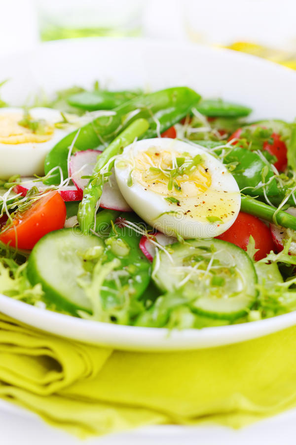 Summer salad of asparagus and green peas stock photography