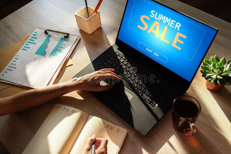 Summer sale, low price offer on device screen. E-commerce and marketing concept. stock photography
