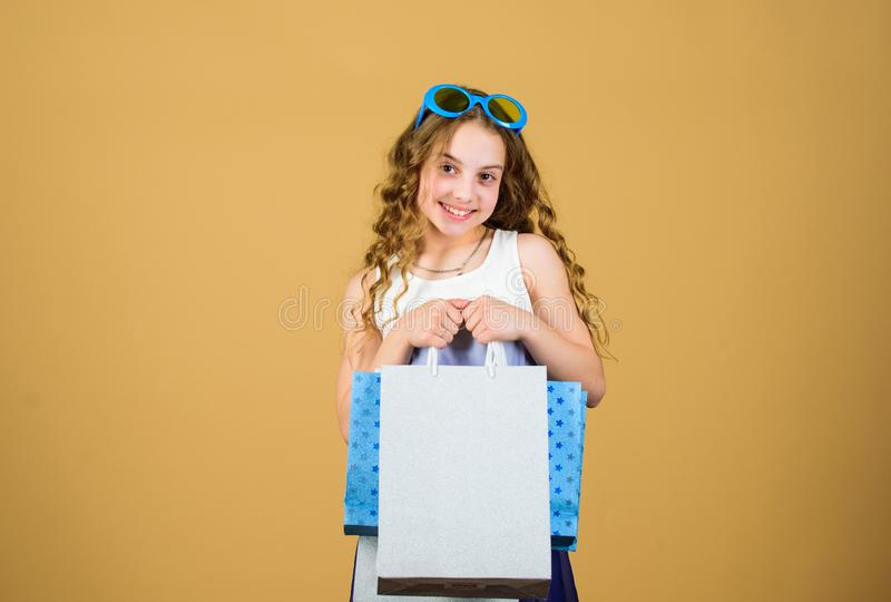 Summer sales. Small girl fashion. happy birthday holiday. Beauty. black Friday discount. cyber Monday. Present and gifts. Buy. happy shopping girl with bags. In stock photo