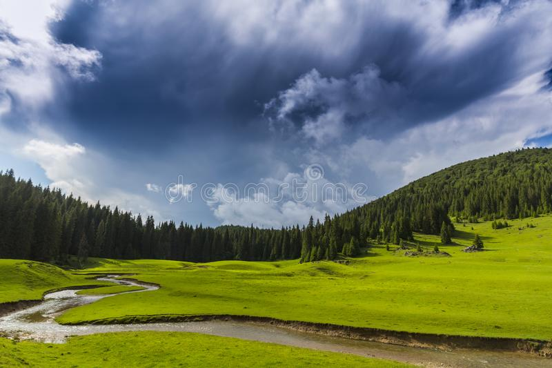 Beautiful summer scenery in remote rural area in the mountains in Europe, with storm clouds stock photography