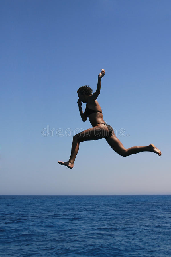 Summer sea jump. Into water royalty free stock photo