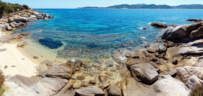 Summer sea coast Halkidiki, Greece. Summer sea scenery with aquamarine transparent water and sandy beach. View from shore Sithonia, Halkidiki, Greece stock photo