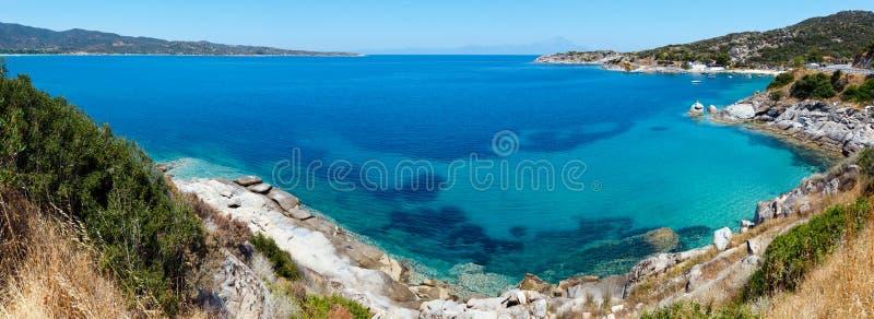 Summer sea coast Halkidiki, Greece. Summer sea scenery with aquamarine transparent water. View from shore Sithonia, Halkidiki, Greece royalty free stock photo