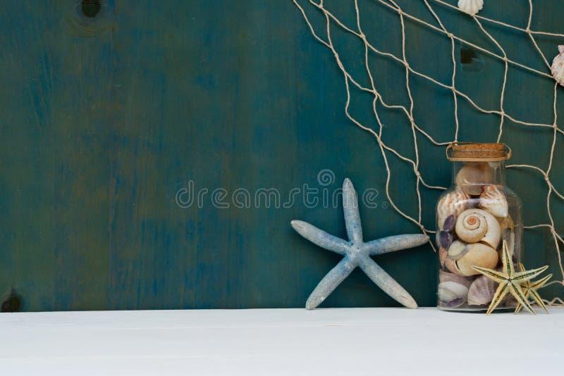 Summer sea still life. With starfish, seashells and fishing net stock photo