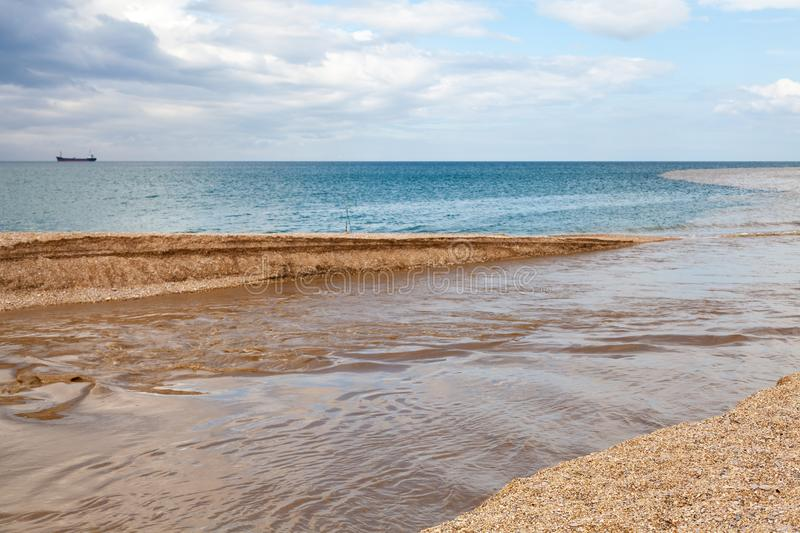 Summer seascape, muddy river water mixed with blue royalty free stock photos