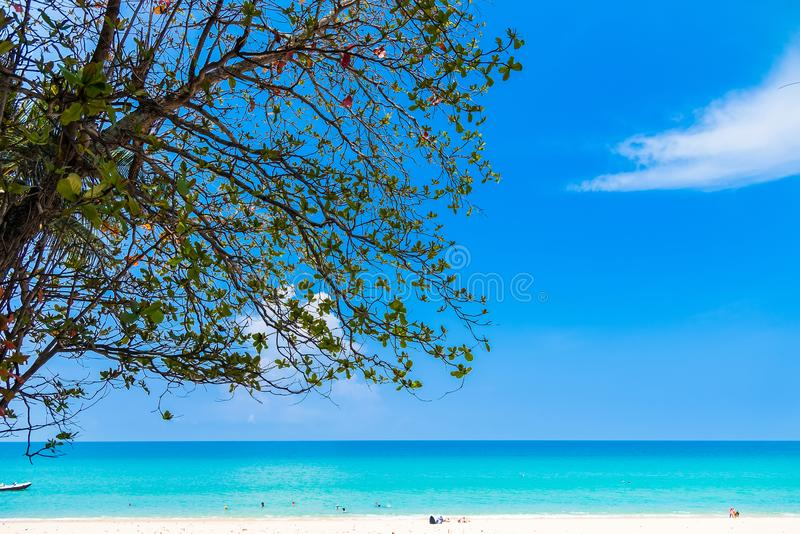 Summer seascape on tropical Phuket island in Thailand. Landscape taken on main long sunrise beach with blue sky and white sand stock image