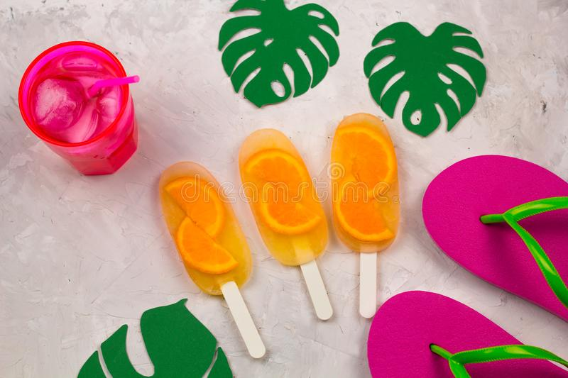 summer set with flip flops, cold cocktail and orange ice cream royalty free stock image