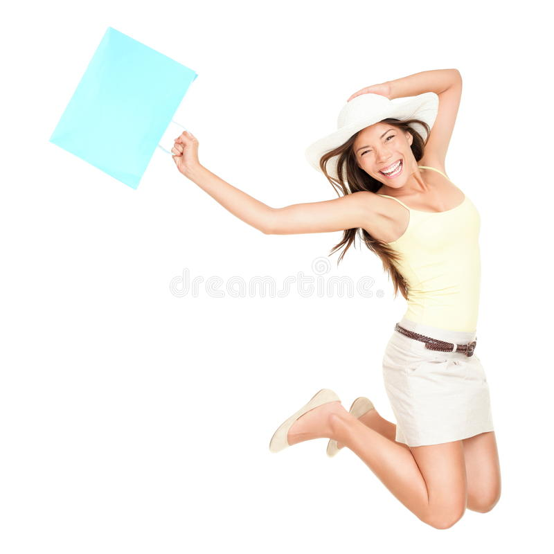 Summer shopping woman jumping. Of joy excited over the summer sales. Beautiful mixed race woman isolated on white background. Asian Chinese and Caucasian
