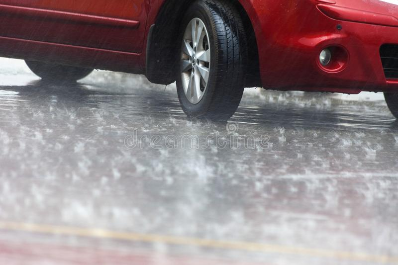Summer shower. Car wheels in the summer rain.  royalty free stock image