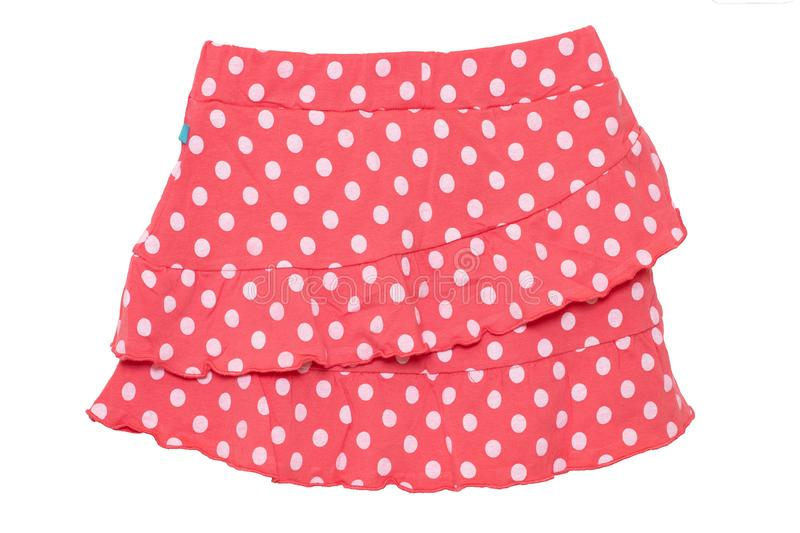 Summer skirt isolated. Closeup of a beautiful red little girl short polka dot skirt isolated on a white background. Children and royalty free stock photography