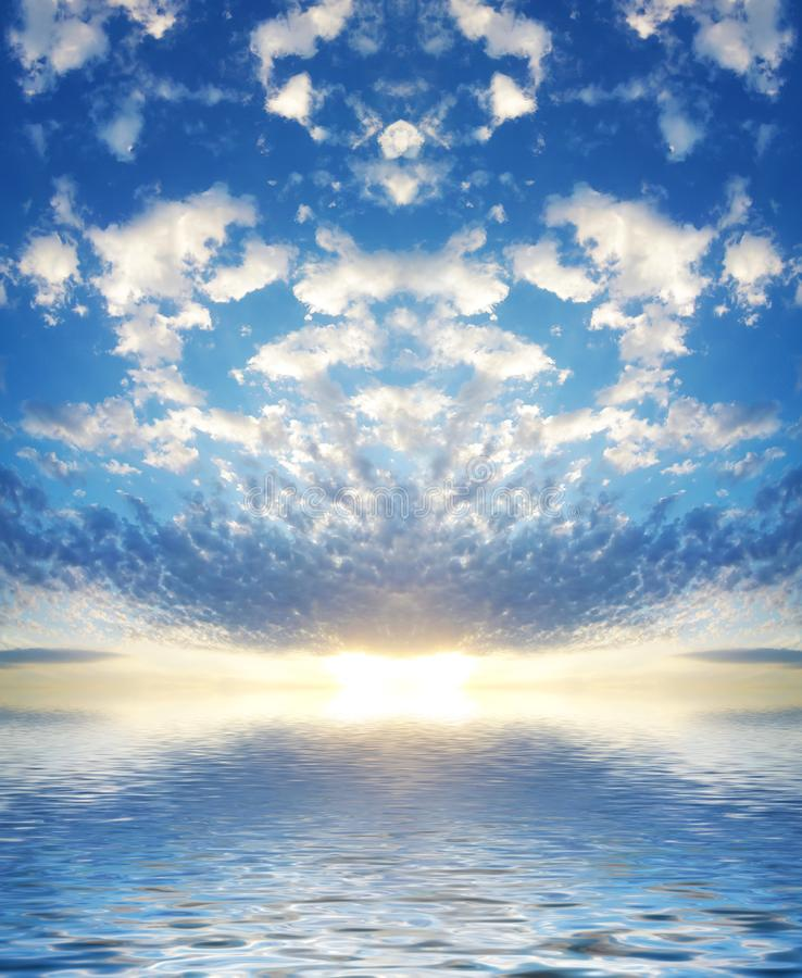 Background of seascape with rising sun. Summer sky with rising sun above calm water.Seascape with beautiful reflection white clouds in sunny weather royalty free stock photo