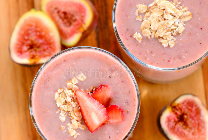Summer smoothie. Fig oats strawberry summer smoothie stock photo