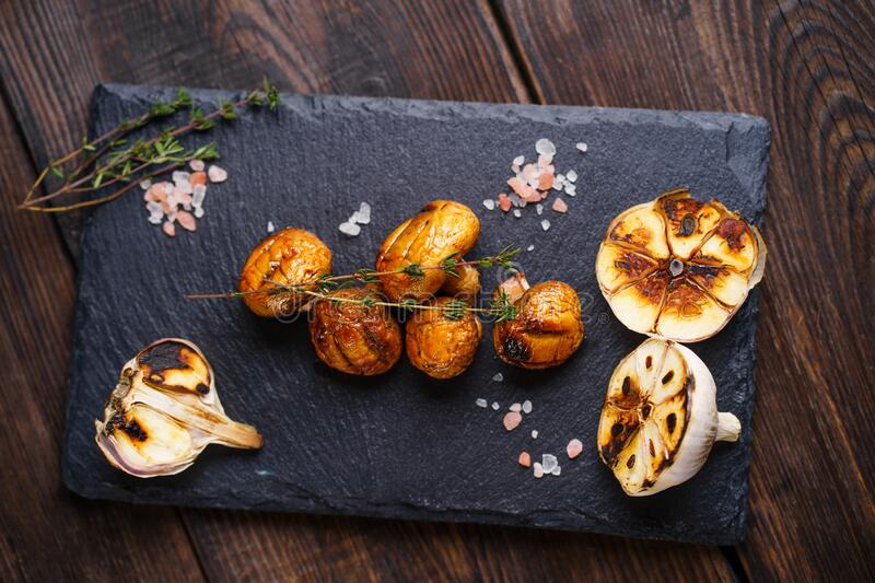 Summer snack, grill bar, barbecue champignons. Summer snack, grill bar, tasty barbecue champignons. Summer delicious healthy food for vegetarians, weekend bbq stock image
