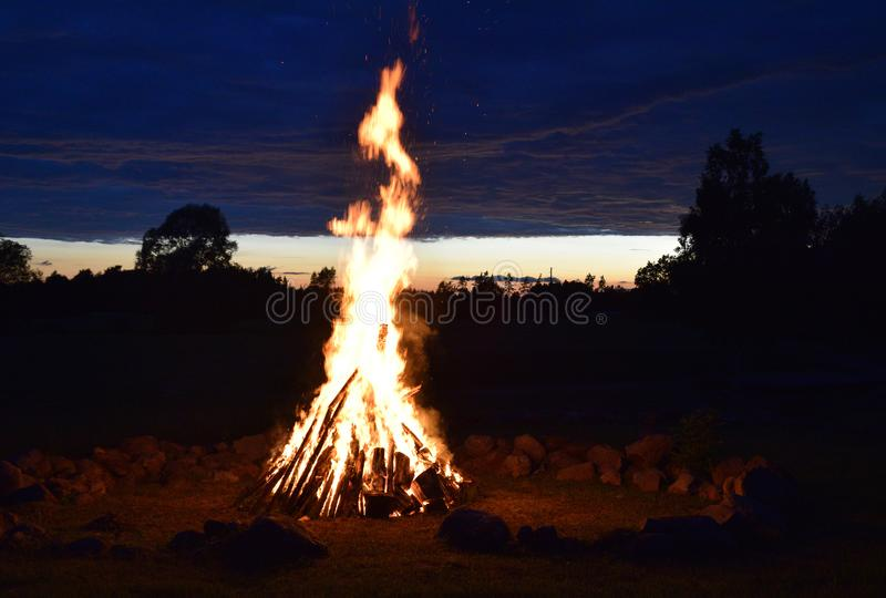 Summer solstice celebration in Latvia. Summer solstice celebration in Latvia, `Ligo` firewood on a midsummer night royalty free stock image