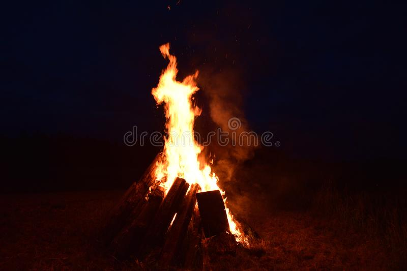 Summer solstice celebration in Latvia. Summer solstice celebration in Latvia, `Ligo` firewood on a midsummer night stock image