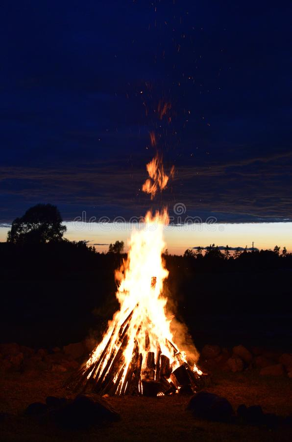 Summer solstice celebration in Latvia. Summer solstice celebration in Latvia, `Ligo` firewood on a midsummer night royalty free stock photo