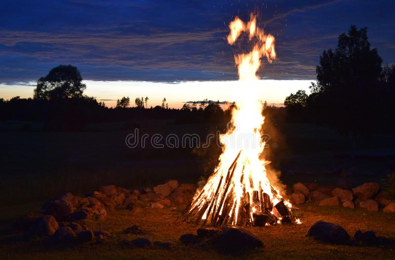 Summer solstice celebration in Latvia. Summer solstice celebration in Latvia, `Ligo` firewood on a midsummer night stock photo