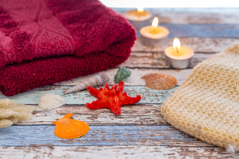 Summer spa concept with seashells, towel, candles, and sponge royalty free stock image
