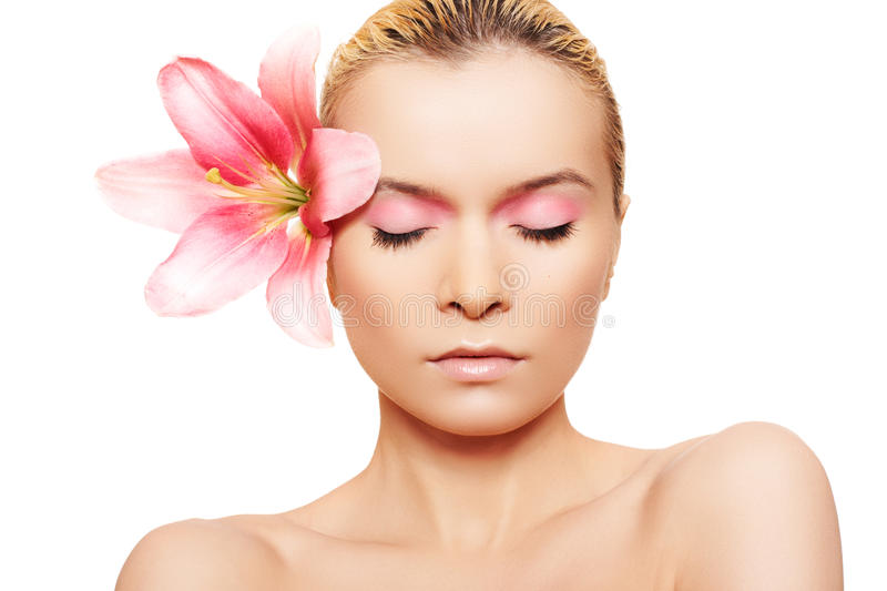 Summer spa woman with beauty pink make-up & flower royalty free stock images
