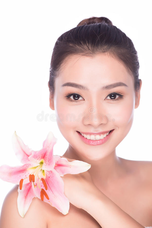 Summer spa woman with beauty pink make-up & flower stock images