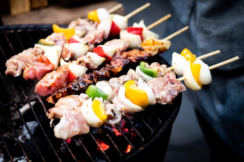 Summer or spring barbecue outdoors Close up Mouth Watering Gourmet Barbecue on Wooden Chopping Board at the Table royalty free stock photos