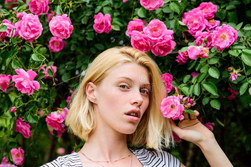 Summer and spring park nature. natural beauty. Spa and skincare. rose flower smell. Parfume. beautiful woman with blonde stock photo