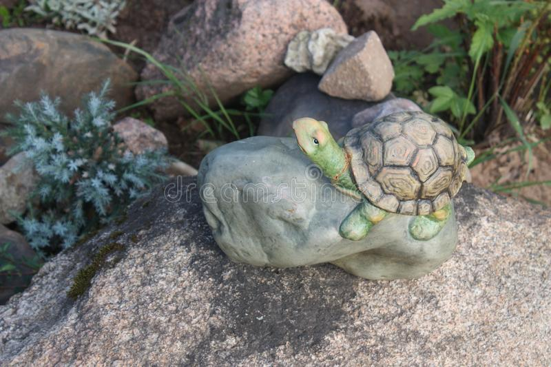 Still life with a toy turtle on a stone royalty free stock images