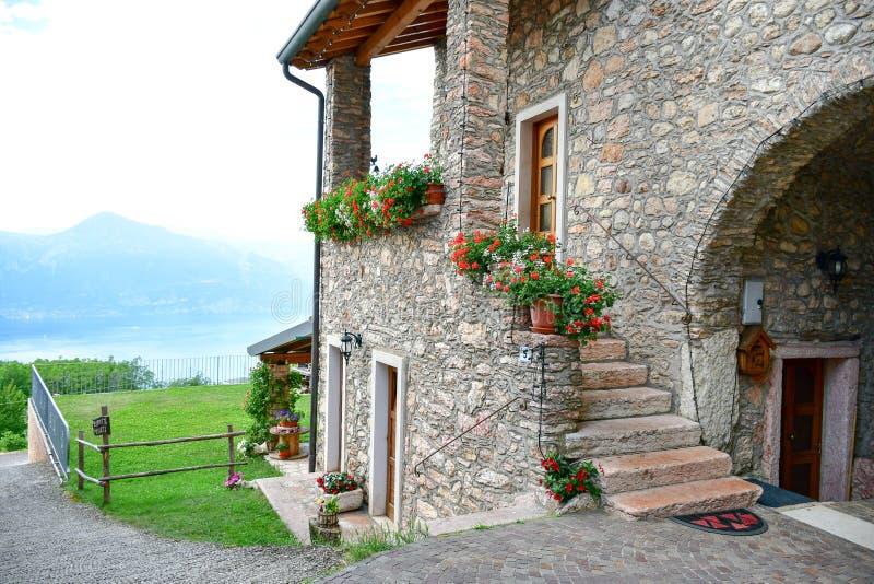 Summer stone House in San Zeno di Montagna, Italy. Veneto, Italy. June 2018. colorful houses in San Zeno di Montagna, a popular health resort located 500 meters royalty free stock photos