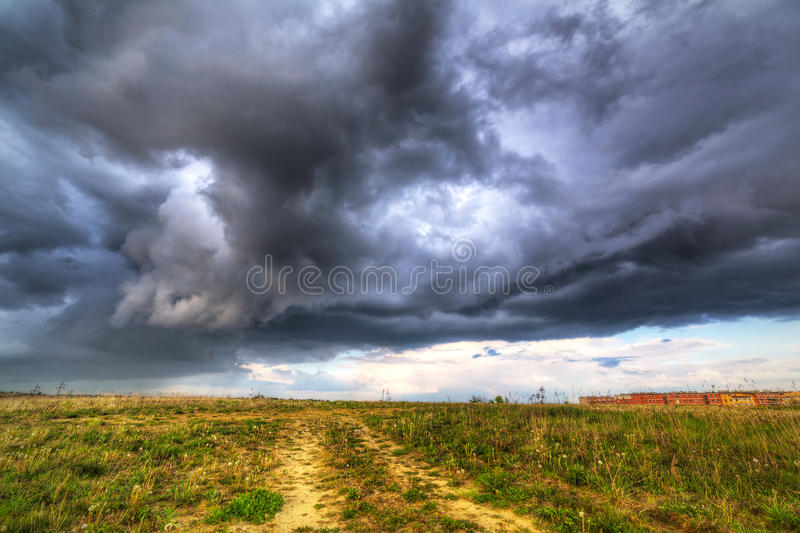 Summer storm over the meadow. In Poland royalty free stock image