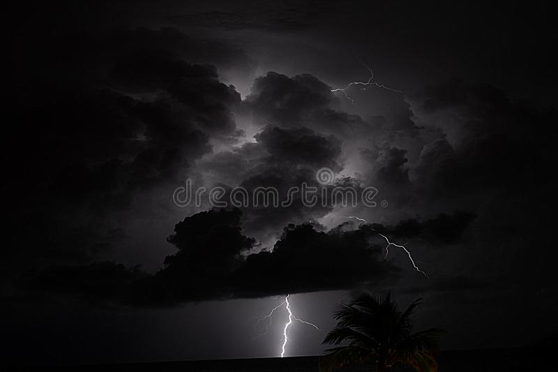Summer storm with strong thunder and lightning make for exciting displays of power. Summertime storms are dramatic displays of nature with thunder and lightning stock photography
