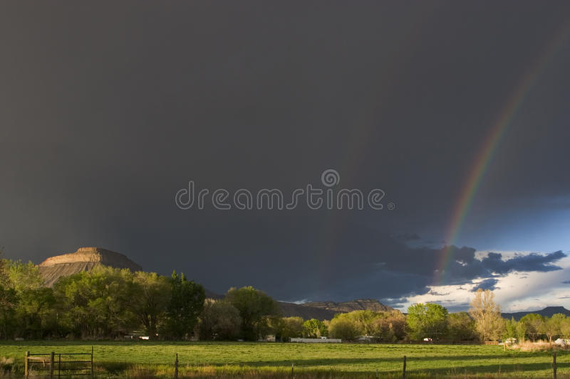 Summer storms. Mount Garfield, Colorado. Storms are few and far between and they often leave a fabulous view afterwords. Lovely double rainbow with great light royalty free stock image