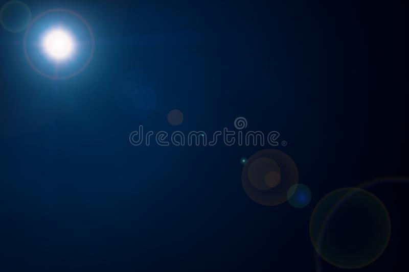 summer sun with sunshine on dark blue sky background texture royalty free stock image