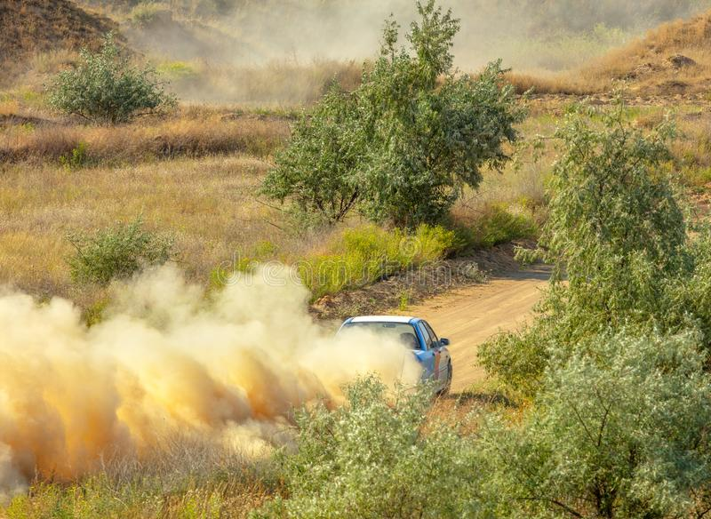 Sports Car on a Bend and a lot of Dust 05 royalty free stock photo