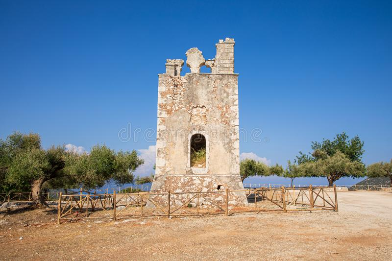 Summer sunny day the old bell tower of the Monastery of Argilion in the open territory for tourist visits - Sami, Kefalonia island stock photography