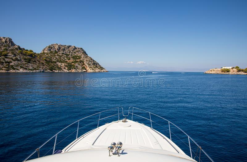 Summer sunny day yachting off the coast of the Agistri - Dorousa islands, Aponisos bay, Saronic Gulf, Greece. Horizontal. Photo taken from the yacht royalty free stock images