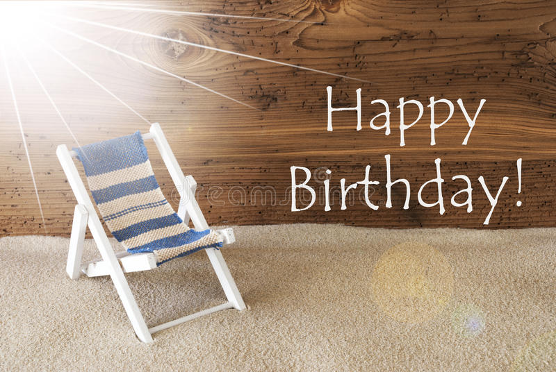 Summer Sunny Greeting Card And Text Happy Birthday. Sunny Summer Greeting Card With Sand And Aged Wooden Background. English Text Happy Birthday. Deck Chair For stock photos
