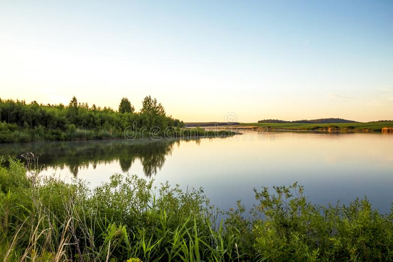 Summer sunny landscape. Morning, dawn on the lake. Saratov Region, Russia. stock photography