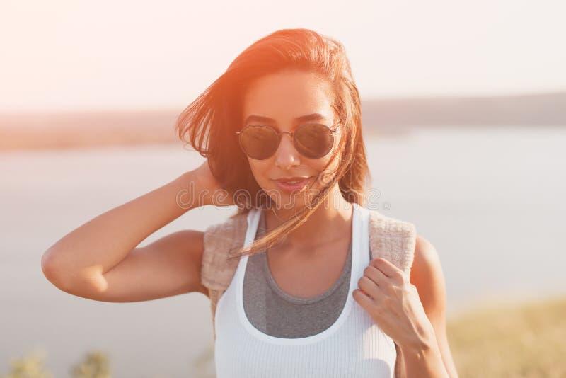 Summer sunny lifestyle fashion portrait of stylish hipster girl stock photography