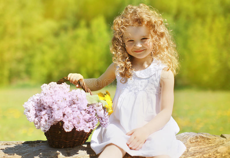 Summer sunny portrait charming curly little girl royalty free stock photography