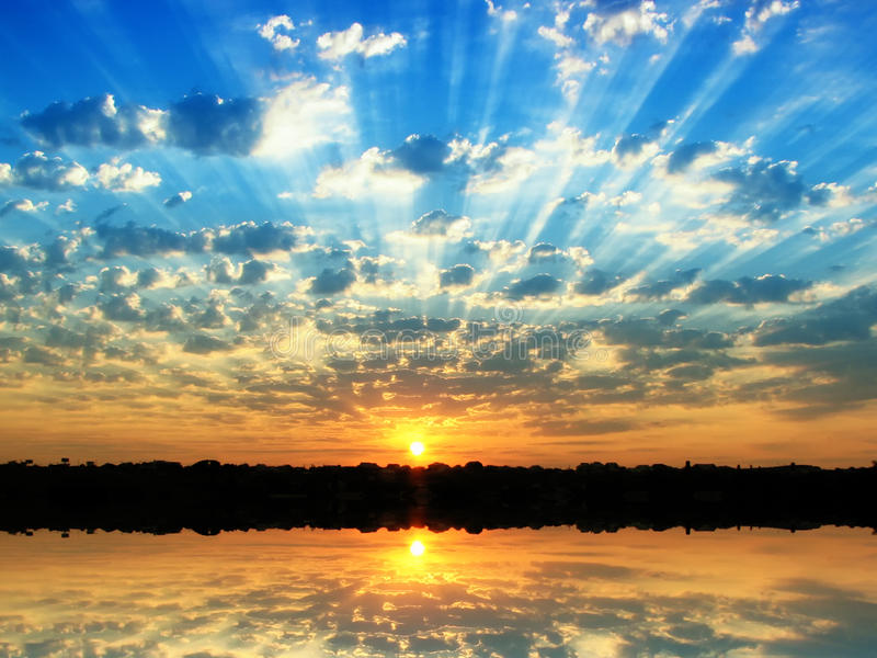 Summer sunrise. Sunrise in the summer at small overcast royalty free stock photo