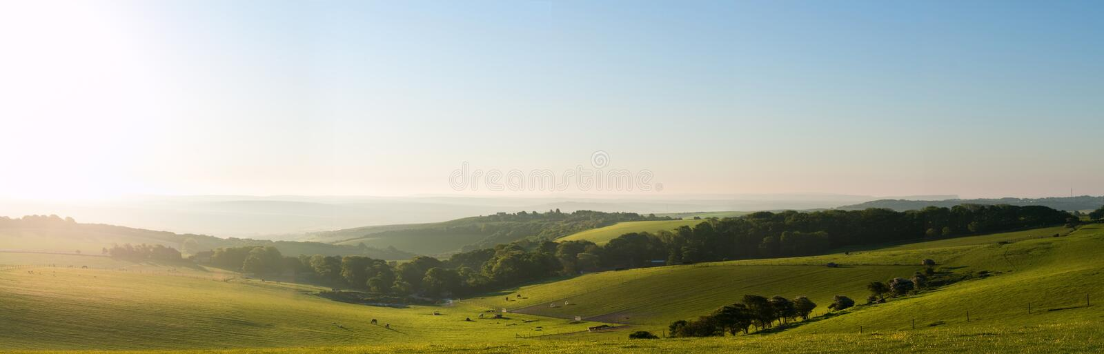Summer sunrise over English countryside landscape stock photography