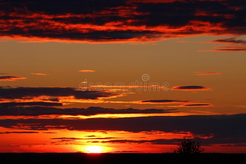 Dramatic clouds on sunset sky. Summer sunset with dramatic clouds stock photo