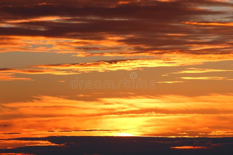 Dramatic clouds on sunset sky. Summer sunset with dramatic clouds stock photos